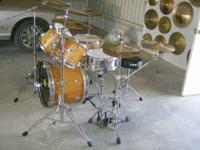 REMOVED WRAP FROM THESE DRUMS AND TREATED WOOD WITH AN
