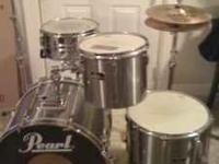 This is a set of silver Pearl Export series drums. It