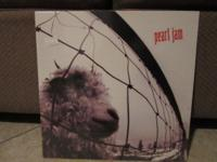 Sealed copy of Pearl Jam VS. album first pressing.