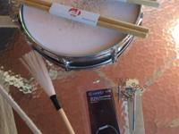 Pearl Piccolo Drum as new with two brand new pair of