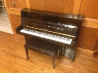 This is a Pearl River Upright Piano UP108D3(Model