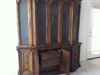 $150- This is a solid Pecan dining room hutch. This