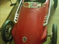 A large pedal car based on Ferrari model F2 of the