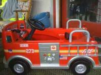 This is a full sizepedal fire truck, Very nice like