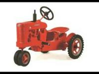 Brand new in box Pedal Tractor. Cast metal Farmall M