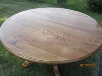 Pedestal Casual Oak Dining Table This gorgeous round