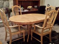 "Beautiful pedestal table with 4 chairs. 42"" across with"