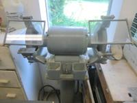 For Sale is a 220V Industrial Pedestal Grinder. It has