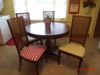 WE HAVE FOR SALE A ROUND WOODEN PEDESTAL TABLE WITH 4