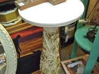 Lamp table beside your reading chair or use as a plant