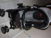 Black and Gray with hint of red. Gently used stroller