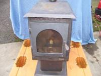 Good working smaller pellet stove.  Art Location: