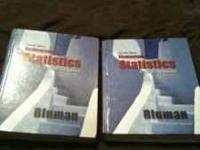 Two statistics books, one has a little water damage but