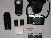 Pentax K1000 with 2 lenes 1)52mm 1)50mm also has filter