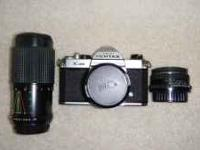 Pentax K1000 35mm manual SLR camera f/2 with 50mm lens.