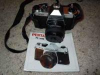 Pentax K1000 body with leather case and use rmanual