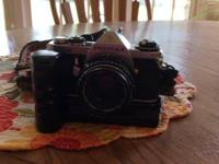 This Pentax camera is in excellent condition and has