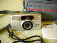 Pentax IQZoom 115V 35 mm film cam includes the initial