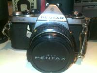 mid 1970's SLR with 28/80mm lens. Just need battery's.
