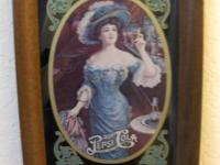 This is a wood framed Pepsi Cola picture. It shows a