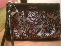 This brand new Coach wristlet has never been used and