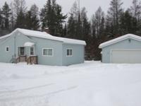 This cute cottage features an open-concept livingarea,