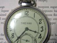 This vintage pocket watch is currently not running. It