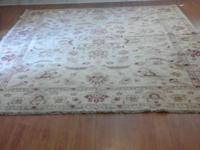 This is a beautiful hand knotted 8.6 x 9.6 rug, never