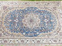 This Persian Rug was hand woven in Iran. It measures