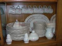 This is a 70 piece Pfaltzgraff Tea Rose Set It is a 6
