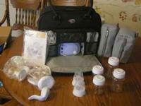 Avent Twin Electric Pump with nice carrying case! This