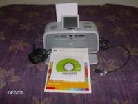 Rarely used photo printer. Prints up to 5x7 photos.
