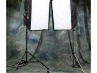I am offering two six bulb soft boxes with stands,