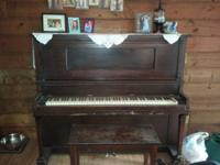 "We ""inherited"" this piano with our house and would love"