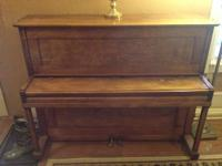 up for sale is an upright piano made by Hollenberg. We