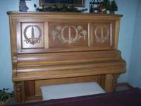 For Sale: Oak upright Grand Piano, with bench Must Sell