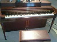 Selling my Awurlitzer piano and bench. firm on the