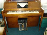 Here is a pianola player piano with lots of rolls it s