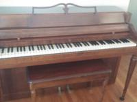 Wurlitzer Spinet Piano (88 keys). It has a mahogany