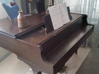 Beautiful, brown, baby grand,piano built in 1985.