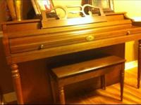 Piano with bench for sale. Good condition. Musical