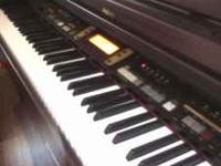 BEAUTIFUL almost new piano - hardly used Mahagany wood