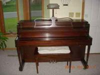 Nice console piano made by Bush & gerts rockford ILL.