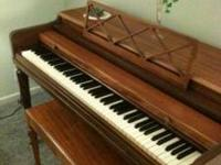 Used Piano...In good shape. Some of the keys are broken