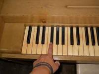 Piano for sale. One flat key does not work-it is the