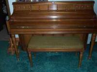 For Sale: Kimball full size upright piano with bench.