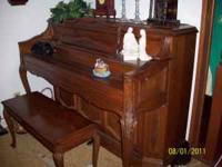 Beautiful Kohler piano and matching bench for sale.