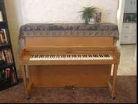 Upright Piano in good condition. I wouldn't be getting