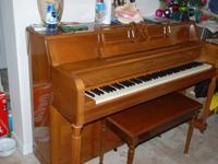 HOBART M. CABLE stand up piano. Color: brown. Great