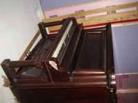Piano free to anyone willing to remove from basement